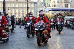 The parade of Santa Clauses on motorcycles around the Main Market Square in Cracow. Stock Photos