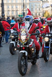 The parade of Santa Clauses on motorcycles Royalty Free Stock Images