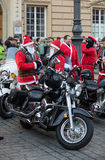The parade of Santa Clauses on motorcycles Stock Images