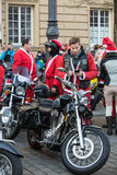 The parade of Santa Clauses on motorcycles Royalty Free Stock Photos