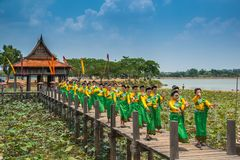 Parade of Thai traditional dancing in Thai traditional costume. Ubon Ratchathani, Thailand - May 2, 2016: Parade of Thai traditional dancing in Thai traditional royalty free stock photo