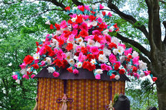 Parade of traditional Aoi festival, Kyoto Japan. Flowerly parasol of parade of the traditional Aoi Matsuri festival, dressed in period costumes, Kyoto Japan Stock Image