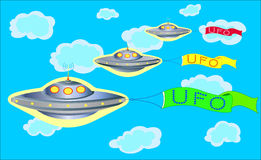 The parade of UFOs in the blue sky. The parade of UFOs in the blue sky with colorful banners with inscriptions UFO Royalty Free Stock Photography
