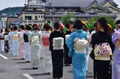 Parade van Gion-festival, bloem parasols Kyoto Japan Stock Afbeelding