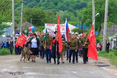 Parade on victory day with the participation of schoolchildren and Cossacks. Adygea, Russia - May 9, 2017: Immortal regiment, Parade on victory day with the Stock Photography
