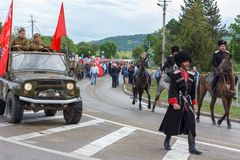 Parade on victory day with the participation of schoolchildren, Cossacks and military equipment. Adygea, Russia - May 9, 2017: Immortal regiment, Parade on Royalty Free Stock Photography