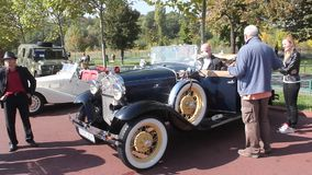 Parade of vintage cars stock video footage