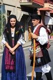 Parade von traditionellen sardinischen Kostümen Lizenzfreies Stockbild
