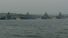 Parade of warships. Parade of Russian military ships in the bay stock video