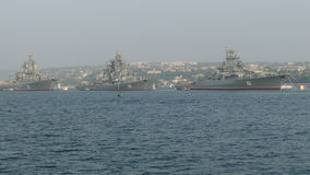 Parade of warships. Parade of Russian military ships in the bay stock video footage