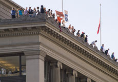 Parade Watchers Atop Building Stock Image