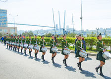A parade of women with the drums in military uniform, marching. May 9, 2017 year. Vladivostok, Russia. royalty free stock photo