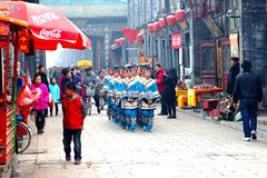 Parade of women in traditional costume, walled city of Pingyao, China Royalty Free Stock Photos
