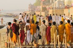 Varanasi/India - March 25, 2017, young hindu priests at riverside of Ganges in Varanasi, Uttar Pradesh, India royalty free stock photography