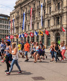 Paradeplatz square in Zurich on the day of the Street Parade. Zurich, Switzerland - 2 August, 2014: people on Paradeplatz square on the day of the Street Parade Royalty Free Stock Photos