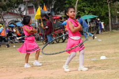 Paraders in local sports festival season. BORABUE, MAHASARAKHAM - DECEMBER 22 : The unidentified paraders are in local sports parade grand opening and festival royalty free stock image