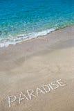 Paradis écrit sur le sable Image stock