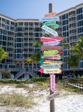 Paradise 0 Miles - Shoes Optional - Ft Myers FL. A colorful sign in front of a Fort Myers Beach waterfront resort points the way to paradise. Shoes optional Stock Photos