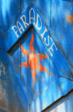 Paradise. A sign for Paradise painted on a wood fence Stock Photography