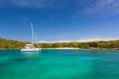 Paradise in Antigua. A single catamaran in a quiet and calm bay in Antigua Royalty Free Stock Photo