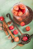 Paradise apples on the wooden table Royalty Free Stock Photos
