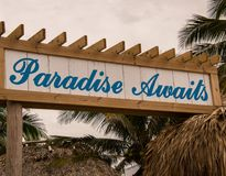 Paradise Awaits sign at Margaritaville Resort. Hollywood, Florida - January 10, 2018: This Paradise Awaits sign was seen by the pool area at the new stock images