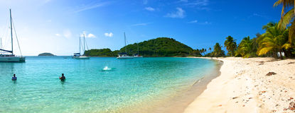 Paradise Beach. Afternoon sun shines down on Mayreau's white sand beach Royalty Free Stock Image