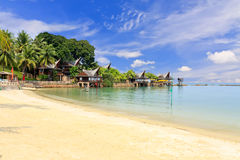 Paradise beach. Tropical Sandy beach with blue sky Royalty Free Stock Images