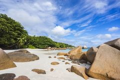 Paradise beach at anse lazio on the seychelles. Turquoise water, granite rocks and palm trees in the white sand on the paradise beach at anse lazio on the Stock Photos
