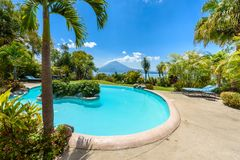Paradise beach with chair at lake Atitlan, Panajachel - Relaxing and recreation with vulcano landscape scenery in the highlands of royalty free stock photography