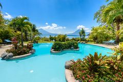 Paradise beach with chair at lake Atitlan, Panajachel - Relaxing and recreation with vulcano landscape scenery in the highlands of stock image