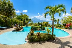 Paradise beach with chair at lake Atitlan, Panajachel - Relaxing and recreation with vulcano landscape scenery in the highlands of stock photography