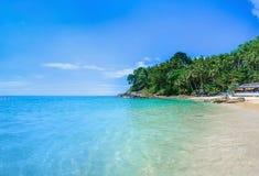 Paradise beach with golden sand, Thailand. Paradise beach with golden sand, azure water and palm trees, Surin beach, Patong area on Phuket Island, Thailand Royalty Free Stock Photo