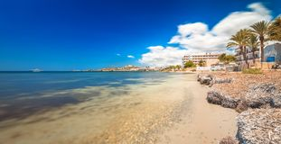 Paradise beach in Ibiza island with blue sky. And crystal water Stock Photos