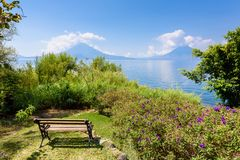 Paradise beach at lake Atitlan, Panajachel - Relaxing and recreation at beach with vulcano landscape scenery in the highlands of royalty free stock images