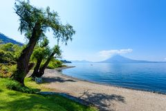Paradise beach at lake Atitlan, Panajachel - Relaxing and recreation at beach with vulcano landscape scenery in the highlands of royalty free stock photo