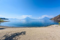 Paradise beach at lake Atitlan, Panajachel - Relaxing and recreation at beach with vulcano landscape scenery in the highlands of royalty free stock image