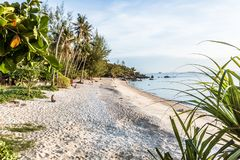 Paradise beach with some people relaxing in the late afternoon sun. Shine. Secret Beach, Haad Son, Koh Pangan, Thailand, May 8, 2016 Royalty Free Stock Photography