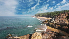 Paradise beach with stones and palm trees, aerial view. Kerala, India. stock video