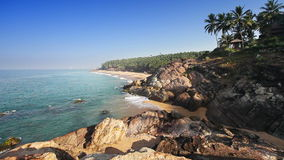 Paradise beach with stones and palm trees, aerial view. Kerala, India. stock footage
