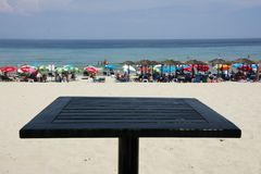 Paradise beach on Thassos island. Thassos island, Greece, June 29, 2015: Paradise beach on east side of Thassos island in Greece, shot from a bar table above the Stock Photos