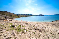 Paradise beautiful beach in  adriatic. Paradise Adriatic beautiful beach with stone and sea, blue and green colors. Isolated beach as a vacation destination and Stock Photography
