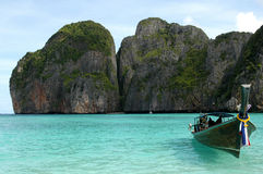 Paradise Boat. This is Phi Phi Island from the movie The Beach. You can see a typical Thai boat Stock Image