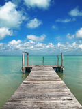 Paradise bridge. An old footbridge in the caribbean sea Stock Photos