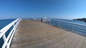 Paradise Cove Malibu Pier. Paradise Cove Pier, a wooden pier in Paradise Cove beach of Malibu, California, United States. Turquoise waters with copy space stock footage