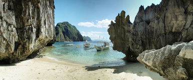 Paradise. El Nido, Palavan, Phillippines relax on boat. Visiting hidden beach, travelling, see rocks, make panorama Stock Photography