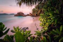 Paradise exotic beach on La Digue Island, Seychelles. Long Exposure during amazing sunset.  royalty free stock photo