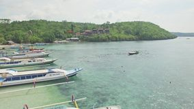 Paradise Harbour Bay Tropics Nusa Penida Bali Indonesia Aerial 4k. Aerial footage of a beautiful harbour with shallow water and coral reef underneath stock video