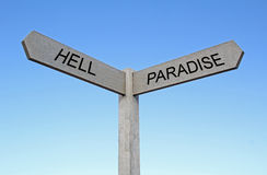 Paradise and hell sign. Photo of two destinations..paradise or hell sign Royalty Free Stock Photography