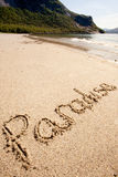 Paradise Island. Paradise written in the sand on a beautiful island Stock Images